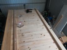 Holzunterstand am Gartenhaus
